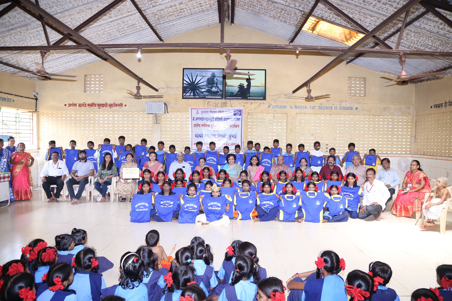 Students proudly display their sports uniforms